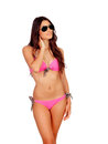 Sexy girl with sunglasses and pink bikini isolated on a white background Royalty Free Stock Photography
