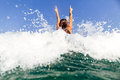 Sexy girl swim sea waves hands up splash back view Royalty Free Stock Photo