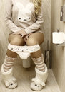 Sexy girl in the toilet funny Stock Photo