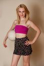 Sexy girl with volley ball pretty blond hair posing in pink top Royalty Free Stock Images