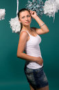 Sexy girl in a white T-shirt and denim skirt Royalty Free Stock Photography