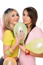 Sexy girls holding a balloon Stock Images