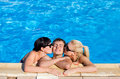 Sexy girls kissing a man in the swimming pool Royalty Free Stock Photo