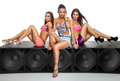 Sexy girls sitting on large speaker friends Stock Image