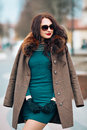 Sexy glamorous brunette girl, beautiful young woman with chic long dark hair, wearing stylish sunglasses, trendy green Royalty Free Stock Photo