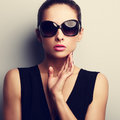 Sexy glamour female model in trendy sun glasses with hand at fac Royalty Free Stock Photo