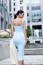 Sexy glamour woman in blue fashion style dress with handbag Royalty Free Stock Photo