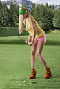 Sexy golf player woman, she is hitting golf ball Royalty Free Stock Photos