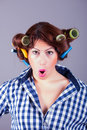 Sexy housewife with curlers pin up portrait of model Royalty Free Stock Images