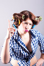 Sexy housewife with curlers portrait of Stock Images