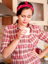 Sexy housewife dislike milk Royalty Free Stock Photos