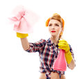 Sexy housewife holding a piece of cloth and a spray studio shot attractive isolated over white background Royalty Free Stock Images