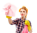 Sexy housewife holding a piece of cloth and a spray studio shot attractive isolated over white background Stock Images