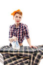Sexy housewife ironing isolated over white background Stock Photography