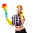 Sexy housewife talking to the phone studio shot of holding a duster and isolated over white background Royalty Free Stock Image