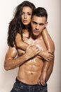 Sexy impassioned couple posing in studio fashion photo of Royalty Free Stock Images