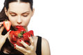Sexy lady holding a juicy strawberry portrait of near her red lips Royalty Free Stock Photos