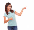 Sexy latin woman pointing to her left Royalty Free Stock Photo