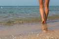 Sexy legs on the beach. Walking female feet Royalty Free Stock Photo