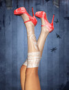Sexy legs and red polka dot shoes Royalty Free Stock Photo