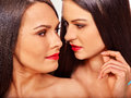 Sexy lesbian women hugging in erotic foreplay game two isolated Stock Photos