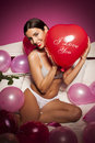 Sexy lingerie woman on the bed with valentines day decorations beautiful Royalty Free Stock Photo