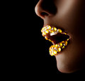 Sexy lips with gems professional golden makeup Stock Photos
