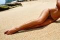 Sexy Long Woman Legs Sunbathing On Beach Sand. Body Part Royalty Free Stock Photo
