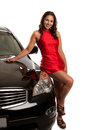 Sexy looking young asian female standing by the car isolated Royalty Free Stock Photos