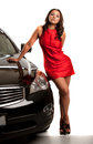Sexy looking young asian female standing by the car isolated Royalty Free Stock Images
