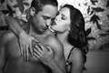 Sexy lovers foreplay at night black and white couple Stock Photography