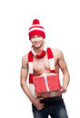 Sexy macho holding red gift Stock Images
