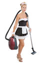 Sexy maid with vacuum cleaner Royalty Free Stock Photo