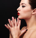 Sexy makeup profile woman face with black nails posing closeup portrait Stock Images