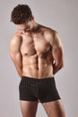 Sexy male model posing without shirt young Stock Photography