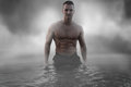 male standing in the water Royalty Free Stock Photo