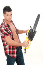 Sexy man with electrical saw in white background Stock Image