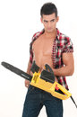 Sexy man with electrical saw in white background Stock Images