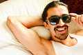 Sexy man in sunglasses young handsome his bedroom Royalty Free Stock Photo