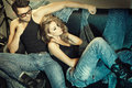 Sexy man and woman dressed in jeans posing Royalty Free Stock Photography