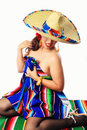 Sexy mexican pin up girl a beautiful hiding her eyes from the camera could be used as a cinco de mayo concept photo Royalty Free Stock Photos