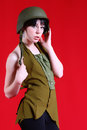 Sexy military girl pretty female isolated on a red background in a fashion pose Stock Photos