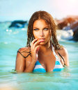 Sexy model girl swimming and posing beauty in the sea Stock Photos