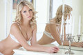 Sexy model posing in lingerie with candelabra portrait of Royalty Free Stock Photo