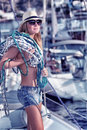 Sexy model posing on sail boat Royalty Free Stock Photo