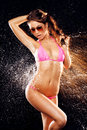 Sexy model in water splash beautiful the drops of the on the black background Stock Image