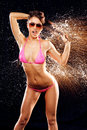 Sexy model in water splash beautiful the drops of the on the black background Royalty Free Stock Photo