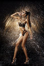 Sexy model in water splash beautiful the drops of the on the black background studio shot Royalty Free Stock Photography