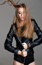 Sexy model wearing leather jacket and black skirt posing fashion Royalty Free Stock Photo