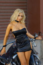 Sexy motorcycle biker girl Royalty Free Stock Photo